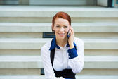 Portrait corporate woman talking on smart phone — Stock Photo