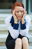 Portrait of a stressed businesswoman having headache — Stockfoto