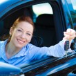 Happy woman showing keys from her new car — Stock Photo