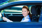 Happy car driver woman smiling — Stok fotoğraf