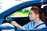 Woman falling asleep, trying to stay alert while driving — Stock Photo