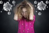 Upset frustrated little girl pullling her hair out — Stock Photo