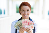 Excited business woman holding currency of different countries — Photo