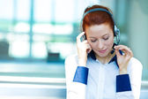 Customer service representative listening to client problem on a — Stock Photo