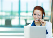 Customer service representative with hands free device on a phon — Stock Photo