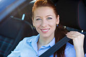 Buckle up. Woman inside black car follows  traffic rules — Stock Photo
