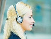 Blonde female customer service representative — Stock Photo