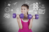 Portrait of a little girl lifting dumbbels — Stock Photo