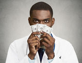 Greedy health care professional, doctor holding cash, money — Stock Photo