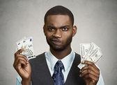 Confused businessman holding dollar, euro bills — Stock Photo