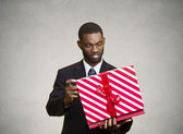 Unhappy man, displeased with new gift — Stock Photo