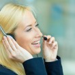 Headshot of a customer service representative talking on a phone — Stock Photo #49358885