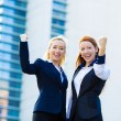 Two ecstatic business woman celebrating success — Stock Photo #49358923