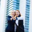 Two excited business women, friends giving victory sign, gesture — Stock Photo #49359123