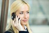 Serious business woman having conversation on a phone — Stock Photo