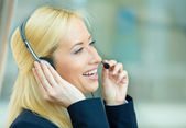 Headshot of a customer service representative talking on a phone — Stok fotoğraf