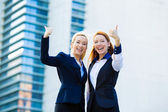 Excited businesswomen giving thumbs up — 图库照片
