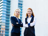 Two confident happy corporate business women — 图库照片