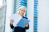 Businesswoman reading, reviewing company documents — Stock Photo