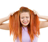 Stressed woman pullling her hair out — Stockfoto