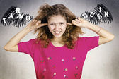 Unhappy stressed girl covering ears from loud noise  — Stock Photo