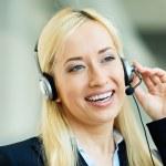 Female customer service representative on hands free device — Stock Photo