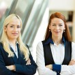 Portrait of two confident happy business women — Stock Photo #50025609