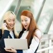 Excited, surpirsed business women receiving good news via email — Stock Photo #50025627