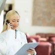 Happy female doctor talking to a patient on a phone — Stock Photo #50025955