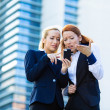 Portrait of two unhappy, dissatisfied business women reading som — Stock Photo #50026401
