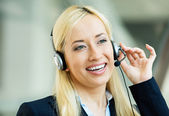Female customer service representative on hands free device — Stock Photo