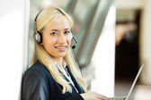 Customer service representative working on computer talking on h — Stock Photo
