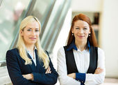 Portrait of two confident happy business women — Stock Photo