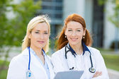 Portrait of female health care professionals, nurses — Stok fotoğraf