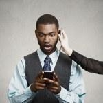 Shocked businessman reading bad news on smart phone, while havin — Stock Photo #50094987
