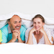 Happy, smiling family under the blanket — Stock Photo #50128987