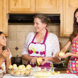 Happy family mother, daughter cooking food on a kitchen — Stock Photo #50128989