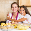 Happy family mother, daughter cooking food on a kitchen — Stock Photo #50129019