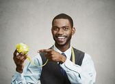 Happy executive advising on healthy diet, holding green apple — Stock Photo