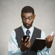 Surprised executive reading breaking news on smart phone — Stock Photo #50183125