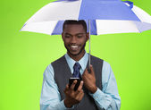 Happy lawyer reading text message on smart phone under umbrella — Stock Photo