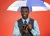 Lawyer reading message on smart phone under umbrella — Stock Photo