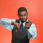 Upset company man giving thumbs down poiting at you — Stock Photo #50271983