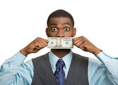 Shocked man with dollar bill curency covering his mouth — Stock Photo