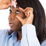 Woman applying eye drops — Stock Photo #50322629