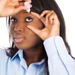 Woman applying eye drops — Stock Photo #50323063