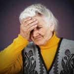 Stressed depressed elderly woman — Stock Photo #50360731