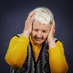 Stressed depressed elderly woman — Stock Photo #50361553