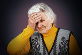 Stressed depressed elderly woman — Stock Photo