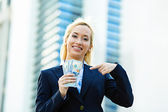 Happy woman holding dollar bills — Stock Photo